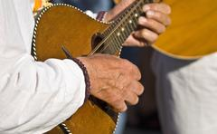 Man playing on the national musical instrument Stock Photos