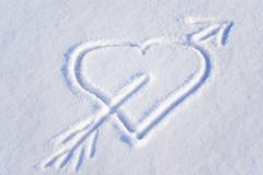 heart on the snow - stock photo