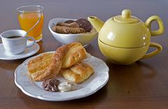 Breakfast set with snack, cookies, juice and coffee Stock Photos