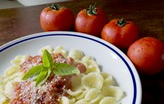 Orecchiette and tomato sauce Stock Photos