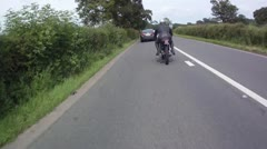 POV Driving Shot fat man riding on vintage motorcycle overtaking cars Stock Footage