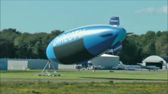 DIRECTV Blimp anchored to field Stock Footage