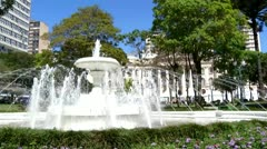 Neoclassical water fountain in a wooded park in the dwntown Stock Footage