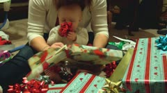 Baby plays with Christmas bows Stock Footage