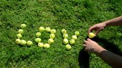 Fast scene word love built apple female male people hand Stock Footage