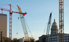 Colorado Capitol Building behind Construction Cranes - stock photo