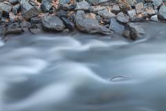 Stock Photo of River and Rocks Long Exposure