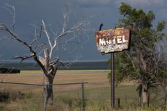 Rusty Old Motel Sign and Tree - stock photo