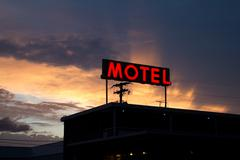 Red Motel Sign with Brilliant Sunset - stock photo