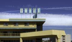 Retro Hotel with Sign Stock Photos