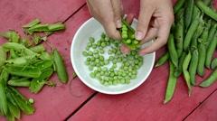Woman hand unhusk pease dish wood table. ecologic food nutrition Stock Footage