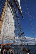 mast, yardarms, rigging and sails .. - stock photo