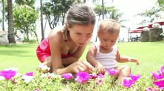 Baby studying flowers Stock Footage
