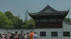 Yuyuan Garden and modern city,Yu Yuan Park, Shanghai, China Stock Footage
