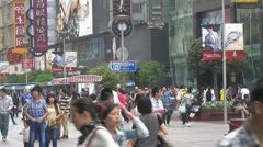 Busy pedestrian shopping street in Shanghai,Nanjing Road, China - stock footage