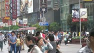 Busy pedestrian shopping street in Shanghai,Nanjing Road, China Stock Footage