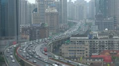 Heavy traffic car jam Shanghai business district congestion financial China day Stock Footage