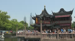 Yuyuan Garden modern city,Yu Yuan Park Shanghai China people crowd tourist day - stock footage