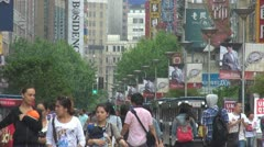 Busy pedestrian shopping street Shanghai downtown Nanjing Road China iconic day - stock footage