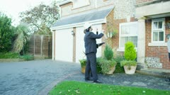 Mature couple hire a surveyor to give them a quote for some building work Stock Footage