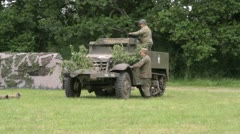 US troops and half track on the battlefield Stock Footage