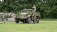 Stock Video Footage of US troops and half track on the battlefield