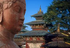 Head of buddha, with pagoda in the background.. Stock Photos