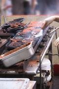 Working a hot grill at seattle .. Stock Photos