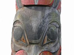 detail, totem pole carved from cedar, .. - stock photo