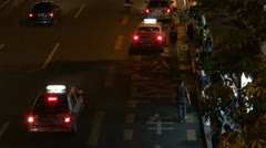 People waiting the bus in bus station by night in Shenzhen, China Stock Footage