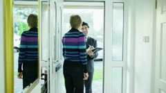 A door to door salesman comes calling Stock Footage