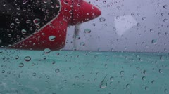 Bumpy seaplane flight on rainy day - stock footage