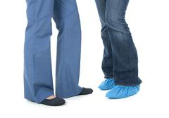 Legs of nurse and patient Stock Photos