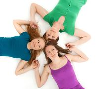 Three coquette girls holding hands - stock photo