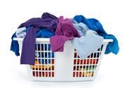 Colorful clothes in laundry basket. Blue, indigo, purple. Stock Photos
