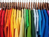 Stock Photo of Colors of rainbow, clothes on wooden hangers