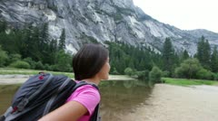 Hiker woman hiking in Yosemite national park. Stock Footage