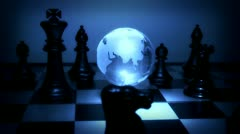 Globe on a chessboard - stock footage