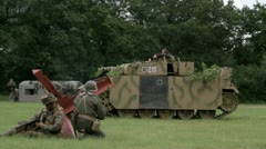 American soldiers attacking German tank Stock Footage