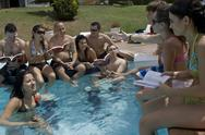 Studying by Pool Stock Photos
