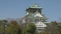 Osaka Castle and plane passing, Japan Stock Footage