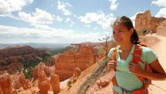 Hiker woman in Bryce Canyon hiking Stock Footage