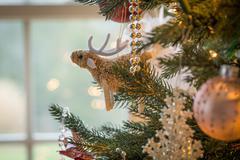 Cute raindeer on christmas tree detail Stock Photos
