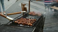 Bake cook meat fire ember outdoor street restaurant Stock Footage