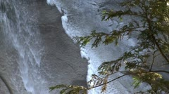 Icy water over rock Stock Footage