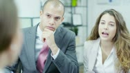 Three attractive business people having a meeting Stock Footage