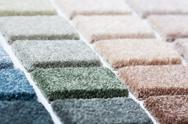 Carpet samples in many shades and colors Stock Photos