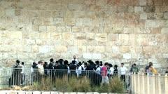 Jewish orthodoxes next to city wall - Jerusalem 2 Stock Footage