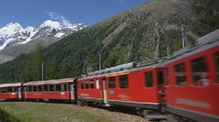 Bernina express in spiral bend climbs up - stock footage