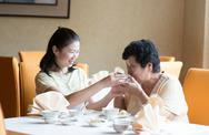 Stock Photo of asian chinese family having meal